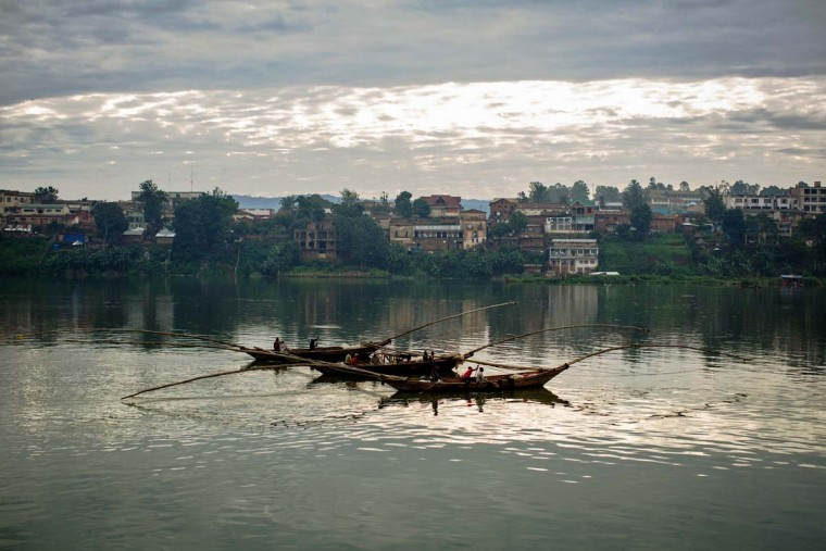 Fishermen are seen returning to Bukavu dock after a night of fishing on March 26, 2015.  || CREDIT: FEDERICO SCOPPA - AFP/GETTY IMAGES