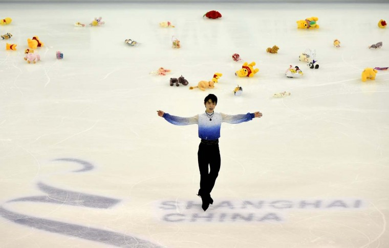 Yuzuru Hanyu of Japan greets the crowd after completing his routine in the men's short program of the 2015 ISU World Figure Skating Championships at the Shanghai Oriental Sports Center in Shanghai on March 27, 2015.      || CREDIT: GOH CHAI HIN - AFP/GETTY IMAGES