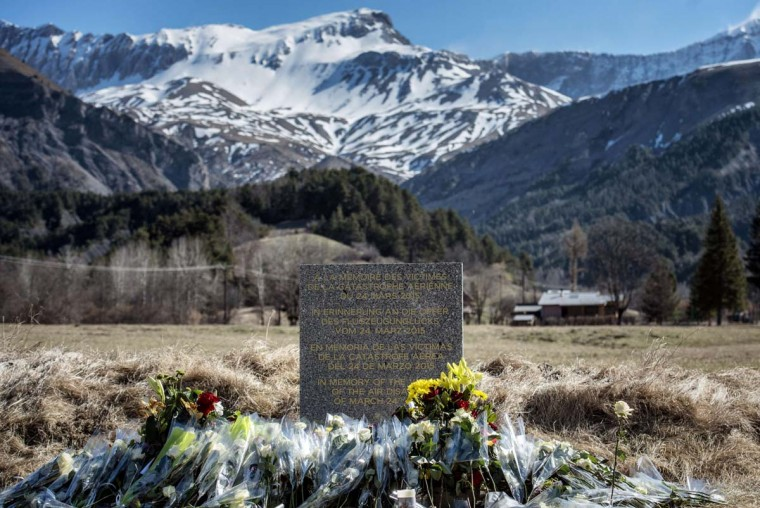 "A stele in memory of the victims of the Germanwings Airbus A320 crash is pictured in the small village of Le Vernet, French Alps, on March 27, 2015, near the site where a Airbus A320 crashed on March 24. The Germanwings co-pilot who flew his Airbus into the French Alps, killing all 150 aboard, hid a serious illness from the airline, prosecutors said on March 27 amid reports he was severely depressed. The stele reads ""In memory of the victims of the air disaster of March 24, 2015"".  