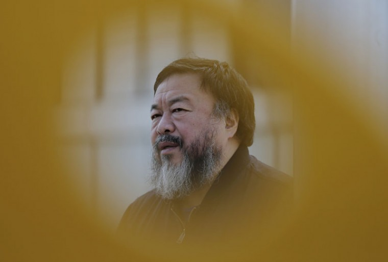 Chinese dissident artist Ai Weiwei speaks during an interview near a playground outside a shopping mall in Beijing on Tuesday. Amnesty International awarded its top honor Tuesday to Ai Weiwei, who has spent years shining light on his country's restrictive political atmosphere, and to U.S. folk singer Joan Baez for her civil rights activism. (Andy Wong/AP)
