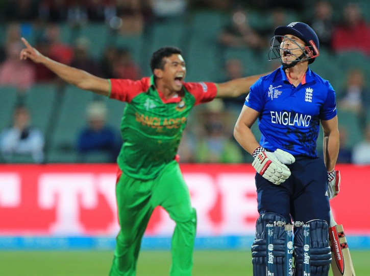 England batsman James Taylor reacts after he was dismissed by Bangladesh bowler Taskin Ahmed, left, during their Cricket World Cup Pool A match in Adelaide, Australia, Monday, March 9, 2015. Bangladesh defeated England by 15 runs. (AP Photo/James Elsby)