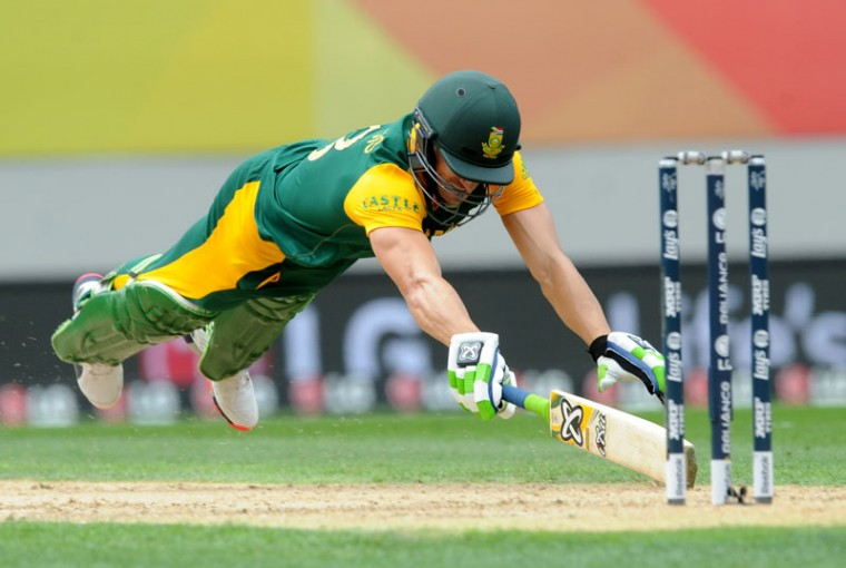 South Africa's Francois Du Plessis dives to make his ground while batting against New Zealand during their Cricket World Cup semifinal in Auckland, New Zealand, on Tuesday. (Ross Setford/AP)