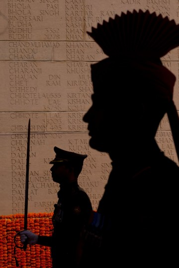 Indian soldiers pay homage as they stand near names of soldiers inscribed on the wall at the India Gate war memorial, in New Delhi, India, Monday, March 9, 2015. The Indian Army will organize a series of events beginning Monday to commemorate the valor and sacrifice of Indian soldiers who fought in the First World War. (AP Photo/Saurabh Das)