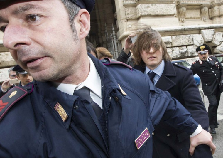 Raffaele Sollecito, right, leaves Italy's highest court building, in Rome, Friday, March 27, 2015. American Amanda Knox and her Italian ex-boyfriend Sollecito expect to learn their fate Friday when Italy's highest court hears their appeal of their guilty verdicts in the brutal 2007 murder of Knox's British roommate Meredith Kercher.  || CREDIT: RICCARDO DE LUCA  - AP PHOTO