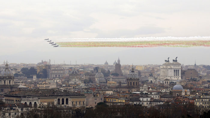 "The ""Frecce Tricolori"" Italian Air Force acrobatic squad fly over Rome on Tuesday to mark the 154th anniversary of the Italian Unification. (Gregorio Borgia/AP)"