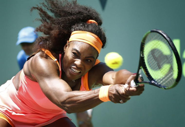 Serena Williams returns the ball to Svetlana Kuznetsova during their match at the Miami Open tennis tournament in Key Biscayne, Fla., Monday, March 30, 2015. Williams won 6-2, 6-3. (AP Photo/J Pat Carter)