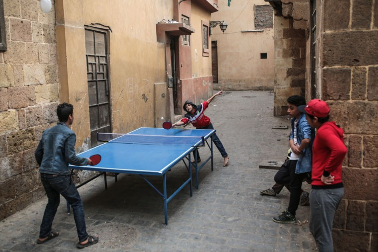 Egyptian boys play table tennis in an alleyway in Islamic Cairo, Egypt, Monday, March 9, 2015. (AP Photo/Mosa'ab Elshamy)