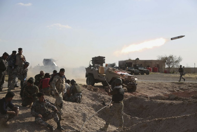 Iraqi security forces launch a rocket toward Islamic State extremist positions during clashes in Tikrit, 130 kilometers (80 miles) north of Baghdad, Iraq, Thursday, March 26, 2015. Iraqi troops started the final phase of an offensive to recapture Saddam Hussein's hometown of Tikrit on Thursday, a military official said, just hours after the United States launched airstrikes on the Islamic State held city. (AP Photo/Khalid Mohammed)