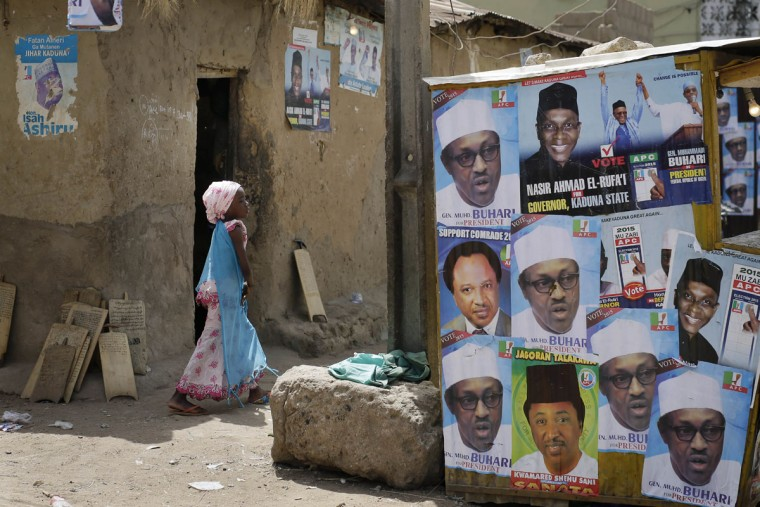A young Nigerian girl walks past election posters, some showing presidential candidate, Muhammadu Buhari, in Kaduna, Nigeria Monday, March 30, 2015. Nigerians are waiting in hope and fear for results of the tightest and most bitterly contested presidential election in the nationís turbulent history. (AP Photo/Jerome Delay)