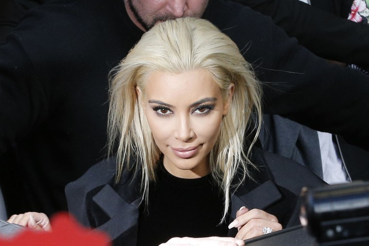 Kim Kardashian leaves Balmain's ready-to-wear Fall-Winter 2015/2016 fashion collection, part of the Paris Fashion Week, Thursday March 5, 2015 in Paris, France. (AP Photo/Christophe Ena)