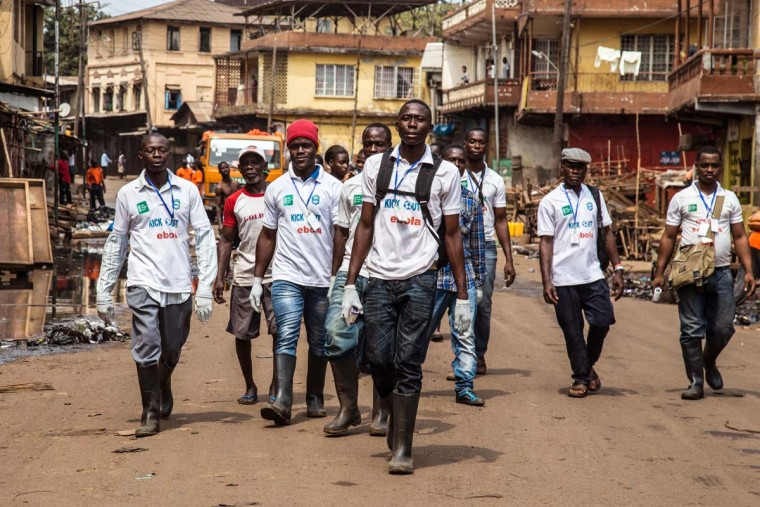 A team of Sierra Leone health workers walk, looking for people suffering from Ebola virus symptoms or people they can educate about the virus as their country enters a three day country-wide lockdown on movement of people due to the Ebola virus. The walk took place in the city of Freetown, Sierra Leone, Friday, March. 27,  2015. Sierra Leone's 6 million people were told to stay home for three days, except for religious services, beginning Friday as the West African nation attempted a final push to rid itself of Ebola.  || CREDIT: MICHAEL DUFF - AP PHOTO
