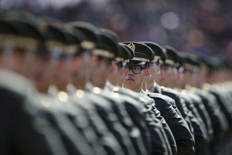 New South Korean military officers attend the joint commission ceremony of 6,478 new military officers of the army, navy, air force and marines at the military headquarters in Gyeryong, south of Seoul, South Korea, Thursday, March 12, 2015. (AP Photo/Lee Jin-man)