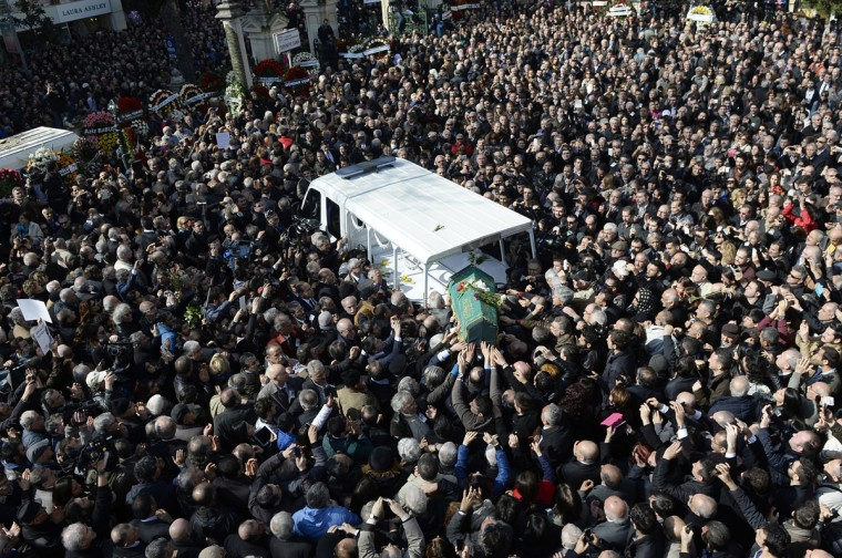 People carry the coffin of Yasar Kemal after funeral prayers at the Tesvikiye Mosque in Istanbul, Turkey, Monday, March 2, 2015. Political leaders and fellow writers were among thousands who gathered for the funeral of Kemal, one of Turkey's best-known novelists. Kemal, whose focus on social injustices brought him into conflict with authority, died on Saturday aged 91. (AP Photo/Emrah Gurel)