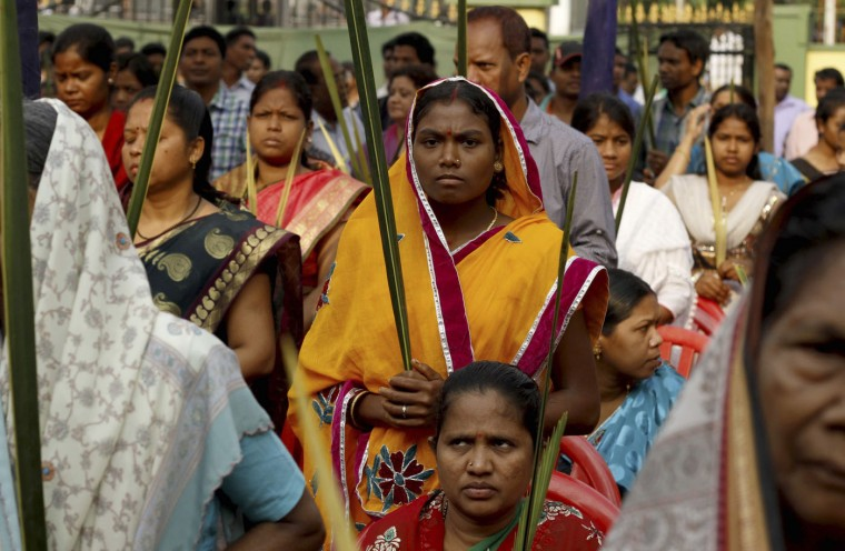Indian Christians hold palm leaves at a mass to mark Palm Sunday in Bhubaneswar, India, Sunday, March 29, 2015. Christians comprise 2 percent of India's more than 1.2 billion people. (AP Photo/Biswaranjan Rout)