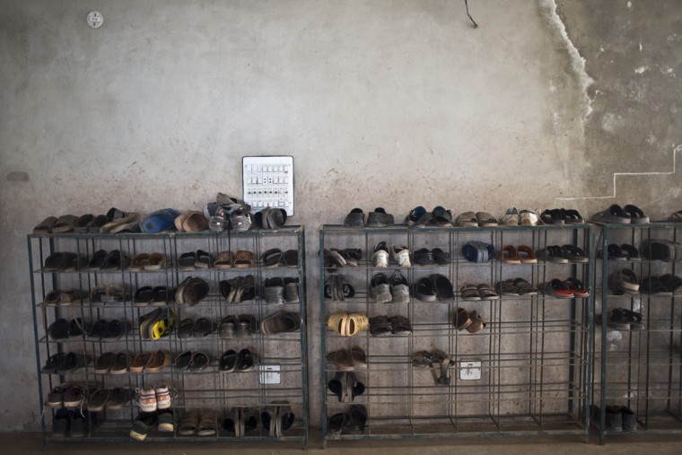 In this Sunday, Jan. 25, 2015 photo, shoes of students of a madrassa, or Islamic school, are placed at the entrance of a classroom in a seminary on the outskirts of Islamabad, Pakistan. Thereís no exact number of madrassas in Pakistan but estimates put the number in the tens of thousands. They provide food, housing and a religious education to students from around the country. Many teach both male and female students. (AP Photo/Muhammed Muheisen)