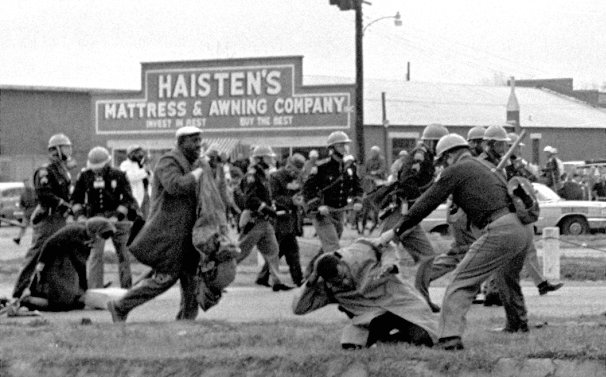 Use clubs against participants of a civil rights voting march in selma