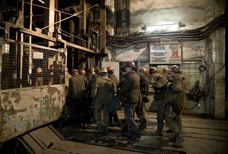 Ukrainian coal miners board an elevator going underground to help search for colleagues and clear up debris following an explosion at the Zasyadko mine in Donetsk, Ukraine, Wednesday, March 4, 2015. (AP Photo/Vadim Ghirda)