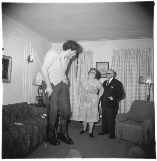 """A Jewish giant at home with his parents in the Bronx, N.Y., 1970. (Diane Arbus)"