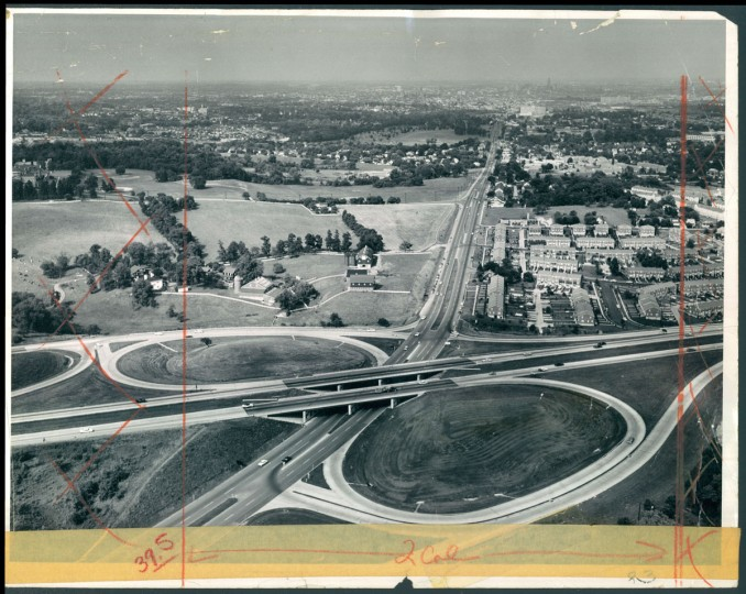 This dramatic aerial photograph shows at a glance how the new Baltimore beltway links communities in the rural, suburban and downtown sections of the Baltimore Metropolitan area. It shows interchange No. 12, where the beltway passes over Wilkens avenue, near Spring Grove State Hospital. (Richard Stacks/Baltimore Sun, 1962)