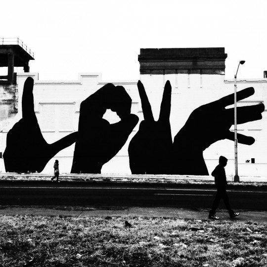 The LOVE mural project painted along E. North Ave. in Baltimore. (Lloyd Fox/Baltimore Sun)