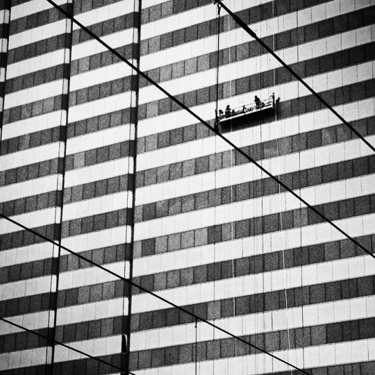 Window washers in downtown Baltimore.  (Lloyd Fox/Baltimore Sun)