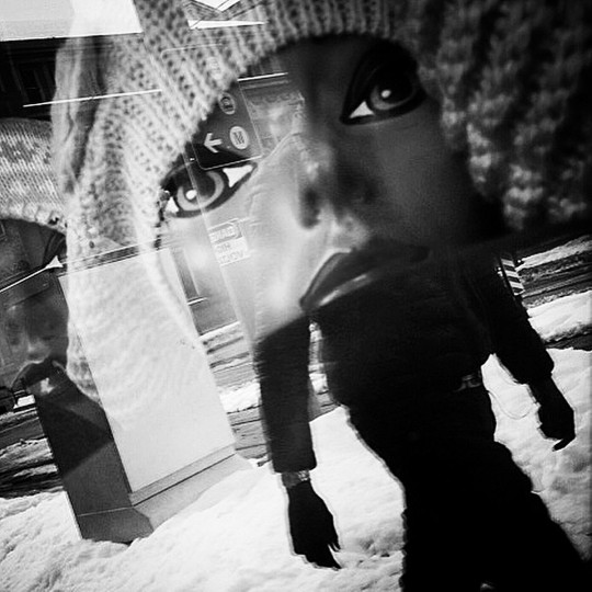 Reflection in a store window along Howard Street in Baltimore. (Lloyd Fox/Baltimore Sun)