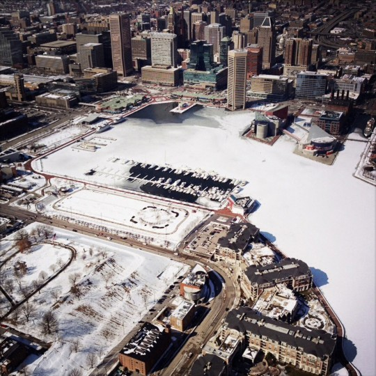 The Baltimore Inner Harbor covered in ice and snow.  Picture was taken from a plane while doing aerial photography of Baltimore.  (Lloyd Fox/Baltimore Sun)
