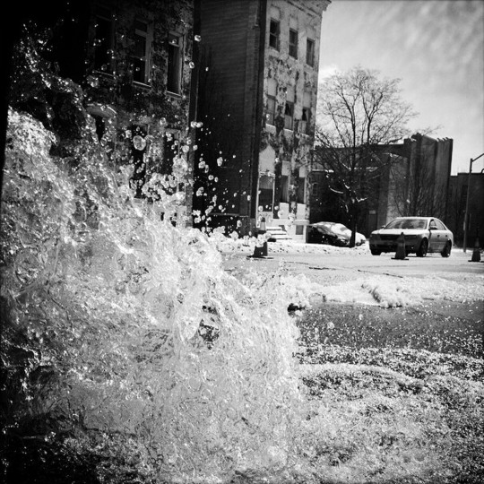 Cold weather causes a water main break in East Baltimore.  (Lloyd Fox/Baltimore Sun)