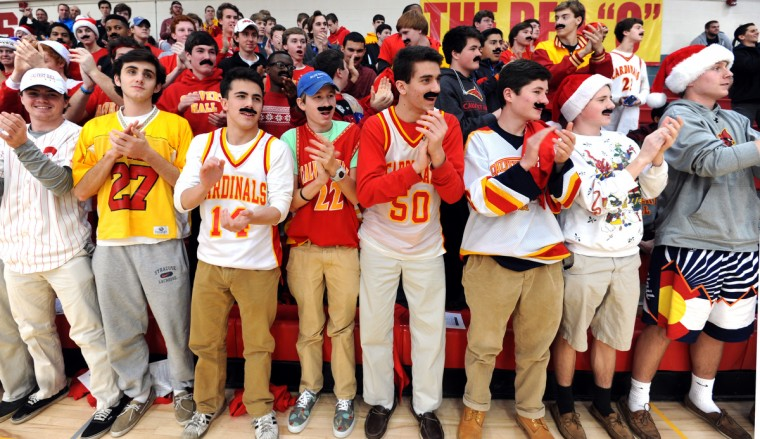 Calvert Hall  fans of longtime coach Mark Amatucci wear mustaches in his honor and applaud as he enters the gym.  Calvert Hall holds a ceremony in the gym to name its basketball court after longtime coach Mark Amatucci. (Algerina Perna/BSMG)