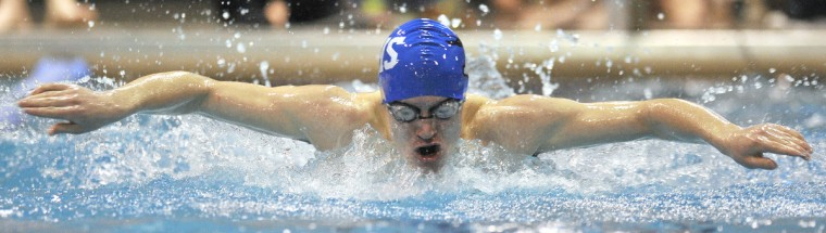 Annapolis' Robert Rice competes in the Boy's 100 Yard Butterfly at the Anne Arundel County Swim Championships at the Arundel Olympic Swim Center in Annapolis. (Matthew Cole/BSMG)