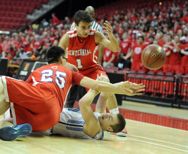 Centennial's Chad Strothers and Min An battle C. Milton Wright's Mychal Stefanides as they go after the loose ball in Thursday night's 3A state semi final win over C. Milton Wright at the Xfinity Center. (Matt Button/BSMG)