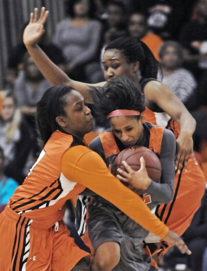 Poly's Maya Horne, center, faces double team defense by City's Daisha Madden, left, and Nkeiruka Okororie in the third quarter. Poly defeated City by score of 53 to 33 in high school girls basketball. (Kenneth K. Lam/Baltimore Sun)