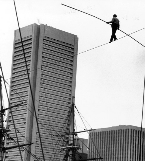 "Sometimes, you even get a guy who wants to get from one spot in the Inner Harbor to the next -- and, perhaps, prefers not to do so on terra firma. In 1973, Karl ""The Great"" Wallenda crossed the harbor over 600 feet of wire 60 feet in the air to mark the opening of the fourth Baltimore City Fair. (Baltimore Sun File Photo)"
