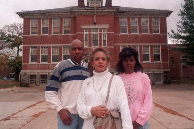 From left, Glord M. McGuire, Joan A. Brooks, and Tracie E. Hamm stand in front of an old elementary school located on Liberty Heights Ave. in the Howard Park Community. Photo taken November 7, 1996. (Algerina Perna/Baltimore Sun)