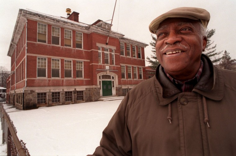 John Saunders, president of the Board of Directors of Forest Park Senior Center, outside the former Howard Park E.S., now vacant, which is adjacent (and connected) to the Senior Center in the 4800 block of Liberty Heights Ave. Photo taken March 10, 1999. (Amy Davis/Baltimore Sun)