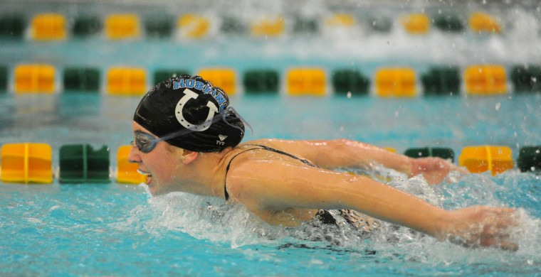 C. Milton Wright's Anne Capozzoli pushes hard as she comes to the turn in the Girl's 100 Yard Butterfly event at Friday night's swim met at North Harford Middle School. (Matt Button/BSMG)