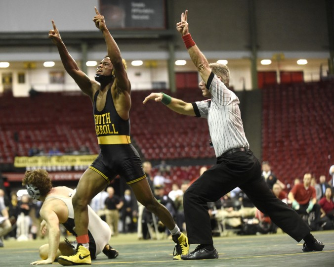 South Carroll's Jamar Williams celebrates his overtime win against Oakdale's Logan McKoy in their 138 pound final during Monday's state wrestling tournament in College Park. (Dylan Slagle/BSMG)