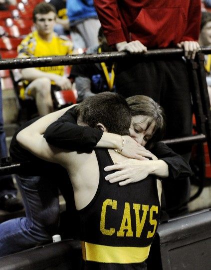 South Carroll's Tim Null embraces his mother Peggy O'Callaghan after defeating Oakdale's Kyle McDonald in their 113-pound final during Monday's state wrestling tournament in College Park. (Dylan Slagle/BSMG)