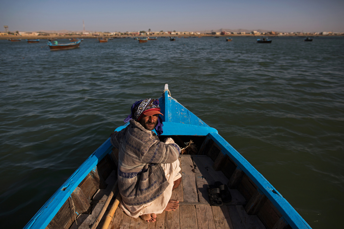 Fishing boat owner Arshad Baloch returns to the village of Abdul Rehman Goth, Pakistan, on Feb. 24 after a weeklong fishing trip. Boats travel farther from the harbor to catch fish because of a decline in fish near the shoreline. (Max Becherer/Polaris Images for The Washington Post)