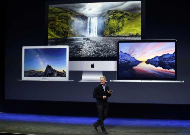 Apple CEO Tim Cook introduces the new Apple MacBook during an Apple event on Monday, March 9, 2015, in San Francisco. (AP Photo/Eric Risberg) Apple CEO Tim Cook introduces the new Apple MacBook during an Apple event on Monday, March 9, 2015, in San Francisco. (AP Photo/Eric Risberg)