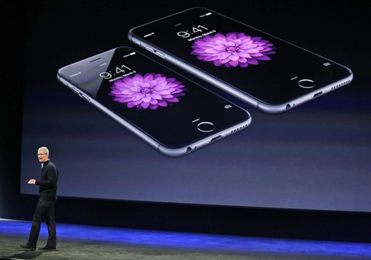 Apple CEO Tim Cook talks about the iPhone 6 and iPhone 6 Plus during an Apple event on Monday, March 9, 2015, in San Francisco. (AP Photo/Eric Risberg)