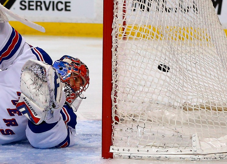 Henrik Lundqvist of the New York Rangers allows a goal by Milan Lucic of the Boston Bruins in the first period at the TD Garden. (Jim Rogash/Getty Images)