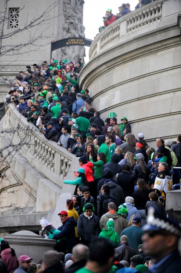 Spectators along the Chicago Riverwalk watch as the Chicago River is dyed green ahead of the St. Patrick's Day parade in Chicago, Saturday. (Paul Beaty/Associated Press)