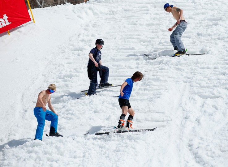 Course workers and athletes prepare the landing area as warm weather greets the aerials competition at the 2015 U.S. Freestyle Ski National Championships at Steamboat Ski Resort at Steamboat Ski Resort Steamboat Springs, Colorado. (Doug Pensinger/Getty Images)