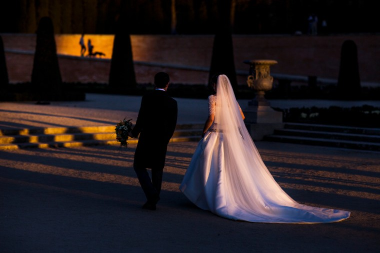 A married couple look for a location to take a wedding photo as people walk their dog during a sunset in Retiro Park in Madrid, Spain. The Retiro Park, a beautifully tended 350-acre garden space where city-dwellers go to get away from the metropolitan hubbub lies in the heart of the city. Originally the formal gardens of a medieval palace, it became King Philip II's 16th-century refuge from court preoccupations, as well as his religious retreat. (Andres Kudacki/Associated Press)