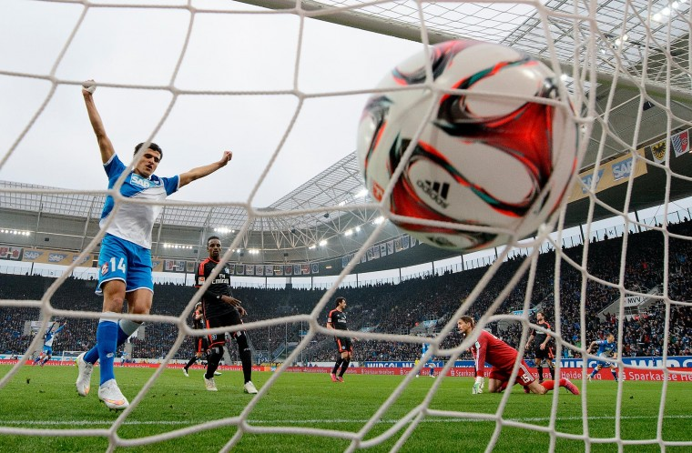 Eugen Polanski (L) of Hoffenheim scores his team's second goal during the Bundesliga match between 1899 Hoffenheim and Hamburger SV at Wirsol Rhein-Neckar-Arena in Sinsheim, Germany. (Matthias Hangst/Getty Images)