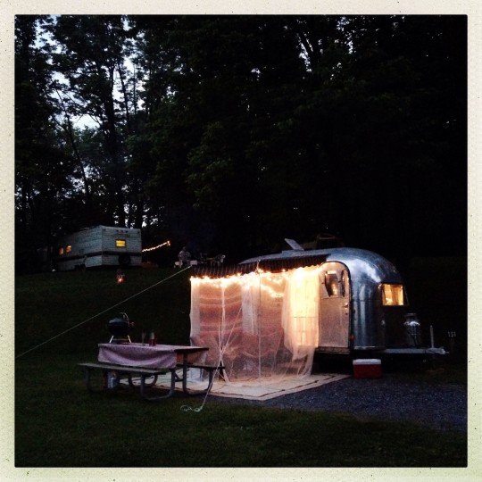 """Lights glow from beneath the awning as """"Ethel"""" sits parked at Starlite Camping Resort in Pennsylvania. (Christopher T. Assaf/Baltimore Sun)"""