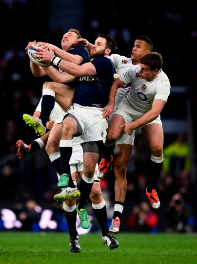 Greig Tonks of Scotland takes a high ball under pressure during the RBS Six Nations match between England and Scotland at Twickenham Stadium in London, England. (Mike Hewitt/Getty Images)