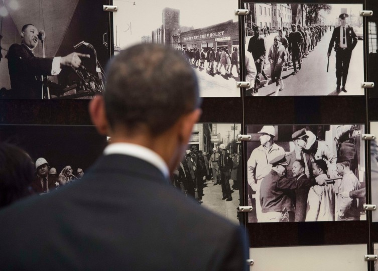 President Barack Obama looks at photos of the original march in Selma during a tour of the National Voting Rights Museum to mark the 50th Anniversary of the Selma to Montgomery civil rights marches in Selma, Ala. (Saul Loeb/AFP-Getty Images)