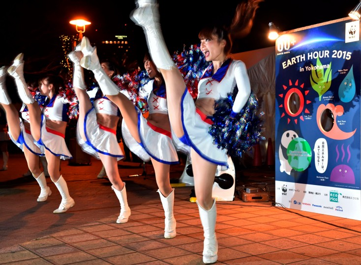 Cheerleaders from Japan's professional football team Yokohama Marinos perform for the countdown of the Earth Hour environmental campaign in Yokohama, suburban Tokyo. Millions are expected to take part around the world in the annual event organized by conservation group WWF, with hundreds of well-known sights set to plunge into darkness. (Yoshikazu Tsuno/AFP-Getty Images)